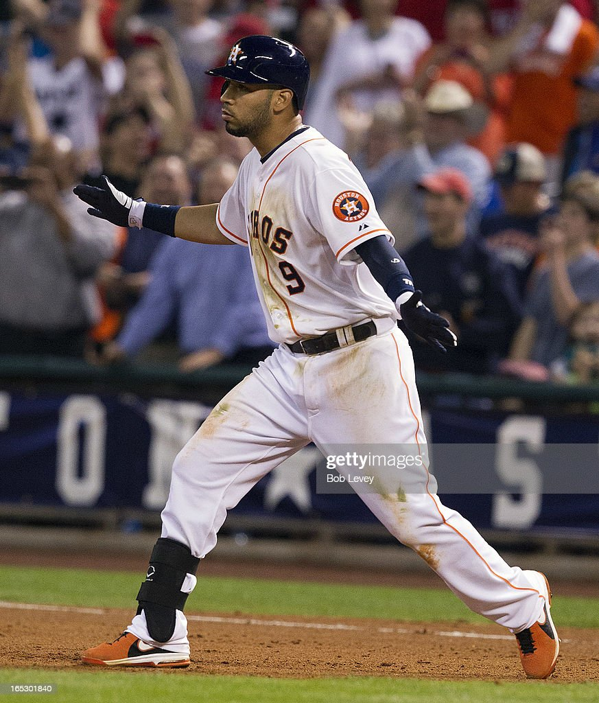 Marwin Gonzalez #9 of the Houston Astros slaps his hands after breaking up a perfect game by Yu Darvish #11 of the Texas Rangers (not pictured) at Minute Maid Park on April 2, 2013 in Houston, Texas.