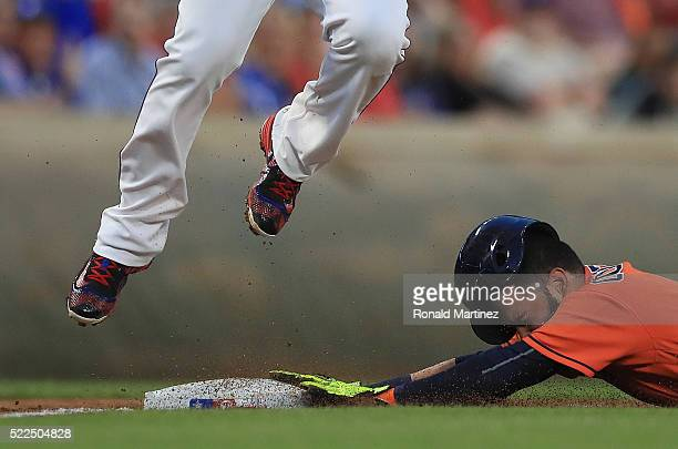 Marwin Gonzalez of the Houston Astros steals third base against Adrian Beltre of the Texas Rangers in the second inning at Globe Life Park in...