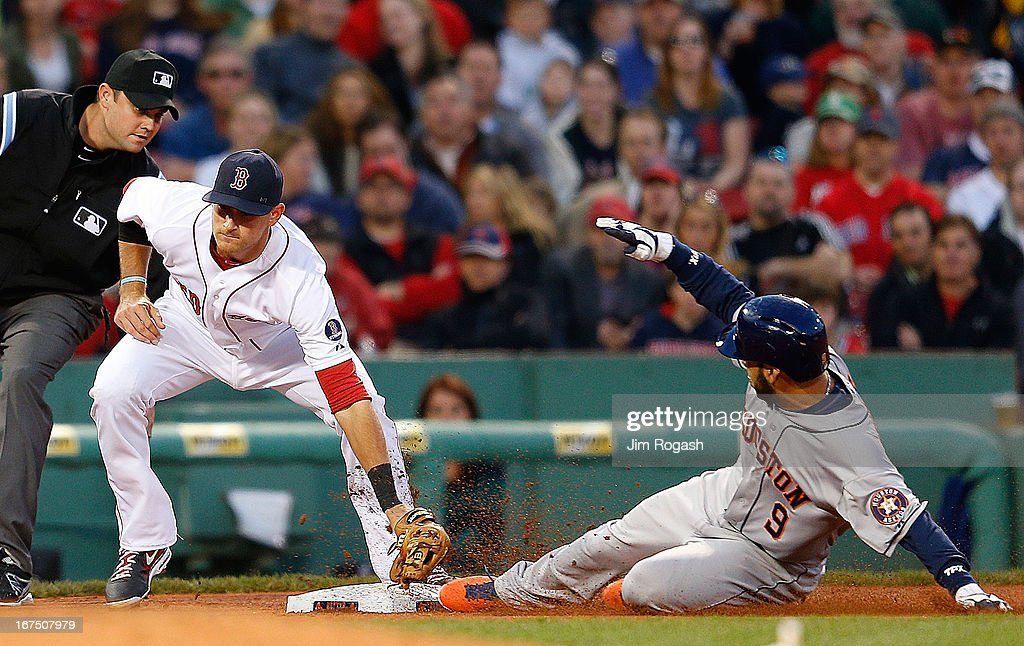 Marwin Gonzalez #9 of the Houston Astros steals third base as <a gi-track='captionPersonalityLinkClicked' href=/galleries/search?phrase=Will+Middlebrooks&family=editorial&specificpeople=7934204 ng-click='$event.stopPropagation()'>Will Middlebrooks</a> #16 of the Boston Red Sox is late with the tag in the 3rd inning at Fenway Park on April 25, 2013 in Boston, Massachusetts.