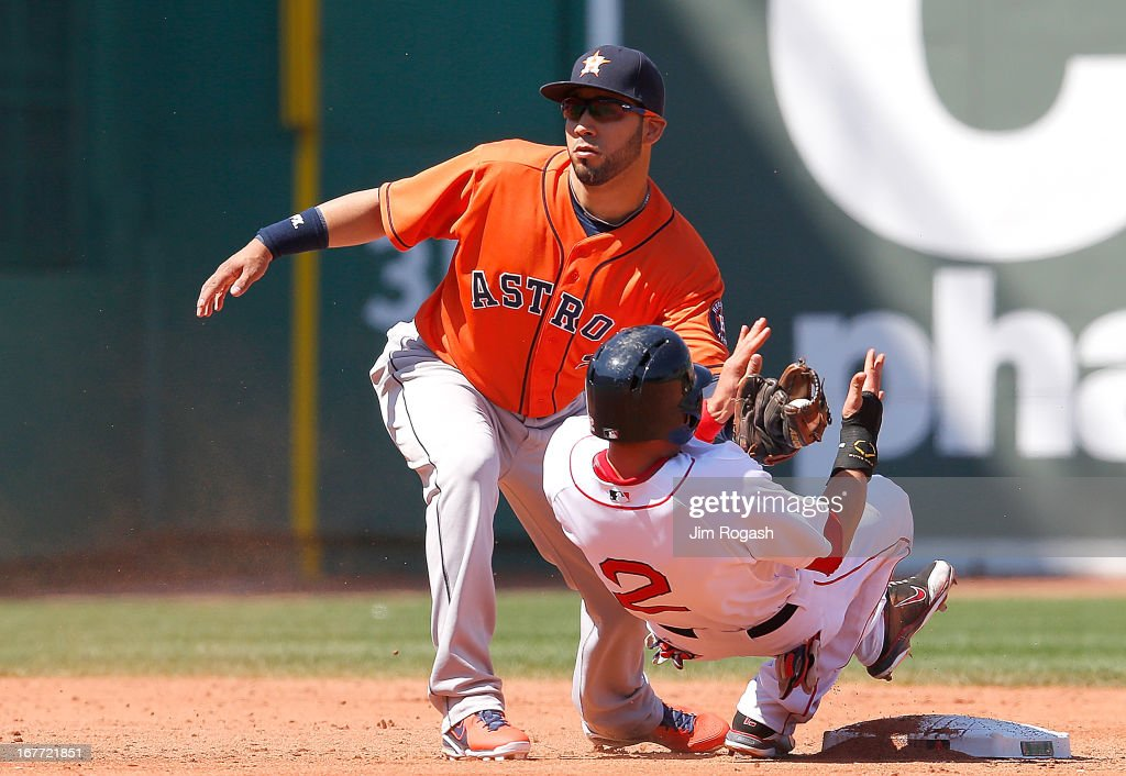Marwin Gonzalez of the Houston Astros tags out Jacoby Ellsbury of the Boston Red Sox in a steal attempt in the 3rd inning during a game with the...