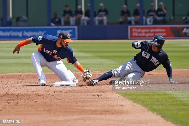 Marwin Gonzalez of the Houston Astros tags out Ronald Torreyes of the New York Yankees as he attempts to stretch a single into a double in the second...