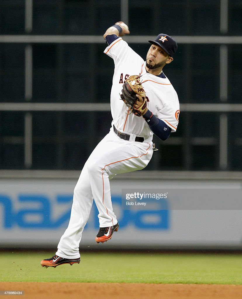 Marwin Gonzalez of the Houston Astros throws off balance to first base to retire Manny Machado of the Baltimore Orioles in the fifth inning at Minute...