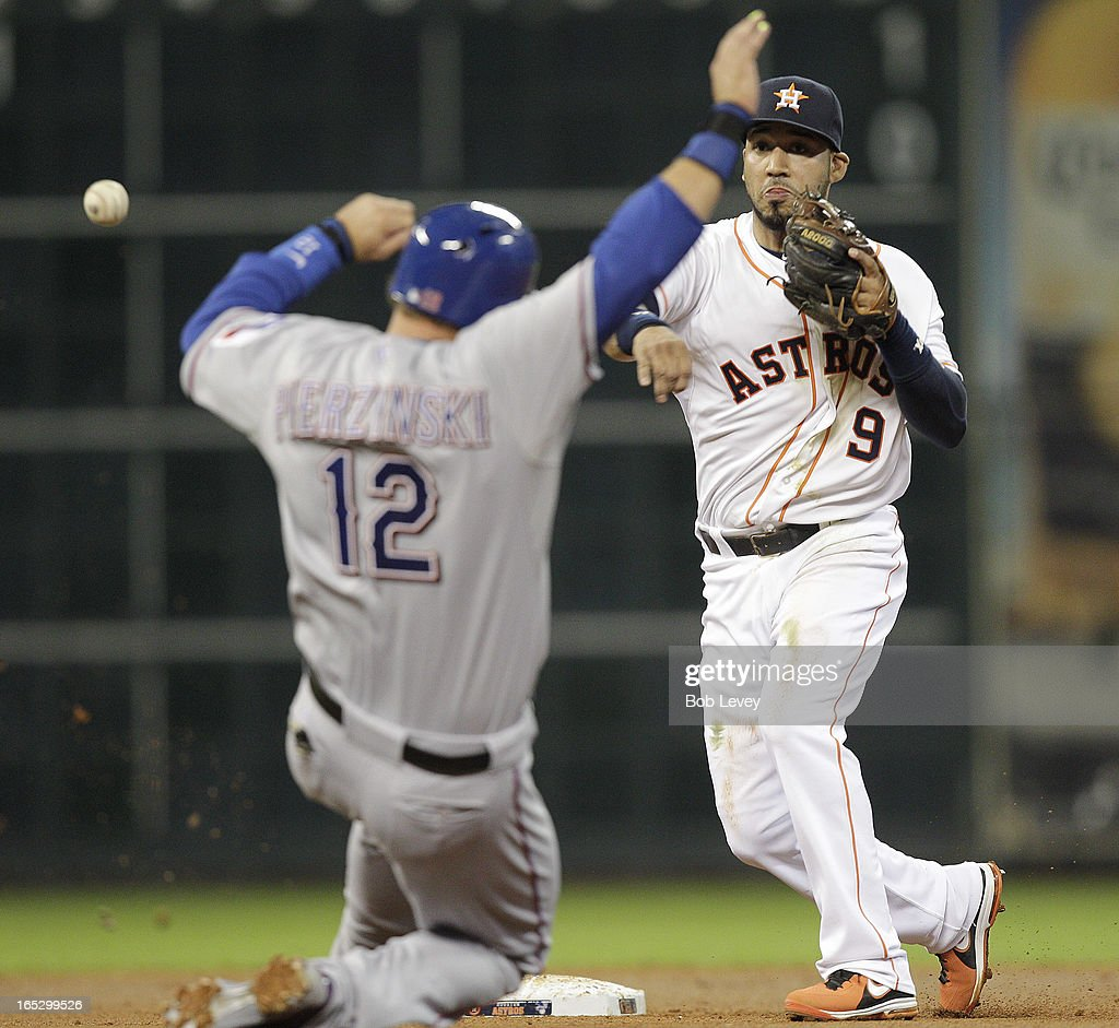 Marwin Gonzalez #9 of the Houston Astros throws over <a gi-track='captionPersonalityLinkClicked' href=/galleries/search?phrase=A.J.+Pierzynski&family=editorial&specificpeople=204486 ng-click='$event.stopPropagation()'>A.J. Pierzynski</a> #12 of the Texas Rangers to complete a double play in the fourth inning at Minute Maid Park on April 2, 2013 in Houston, Texas.