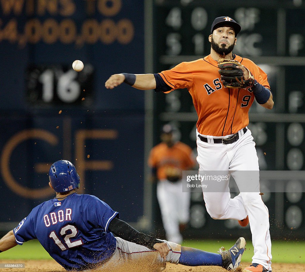 Marwin Gonzalez #9 of the Houston Astros throws to first base over <a gi-track='captionPersonalityLinkClicked' href=/galleries/search?phrase=Rougned+Odor&family=editorial&specificpeople=12505074 ng-click='$event.stopPropagation()'>Rougned Odor</a> #12 of the Texas Rangers to complete a double play to end the game at Minute Maid Park on August 8, 2014 in Houston, Texas.
