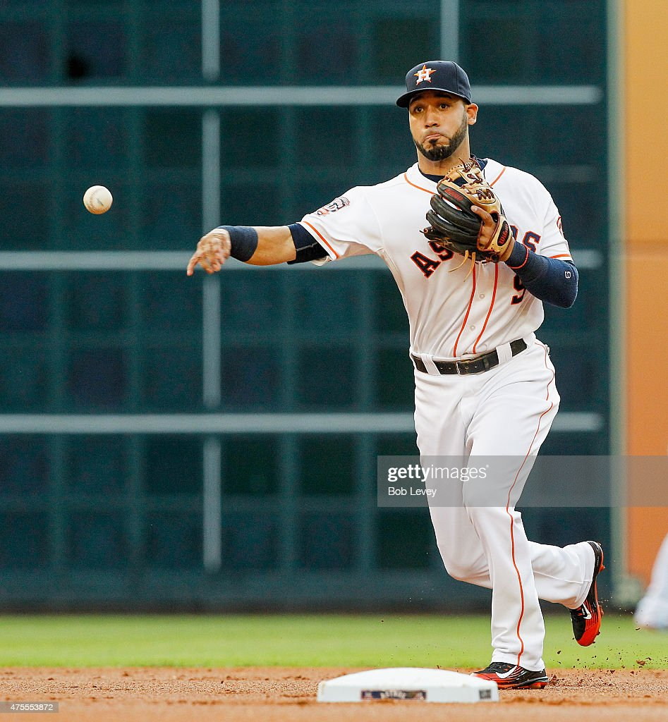 Marwin Gonzalez of the Houston Astros throws to first base to retire David Lough of the Baltimore Orioles in the first inning at Minute Maid Park on...