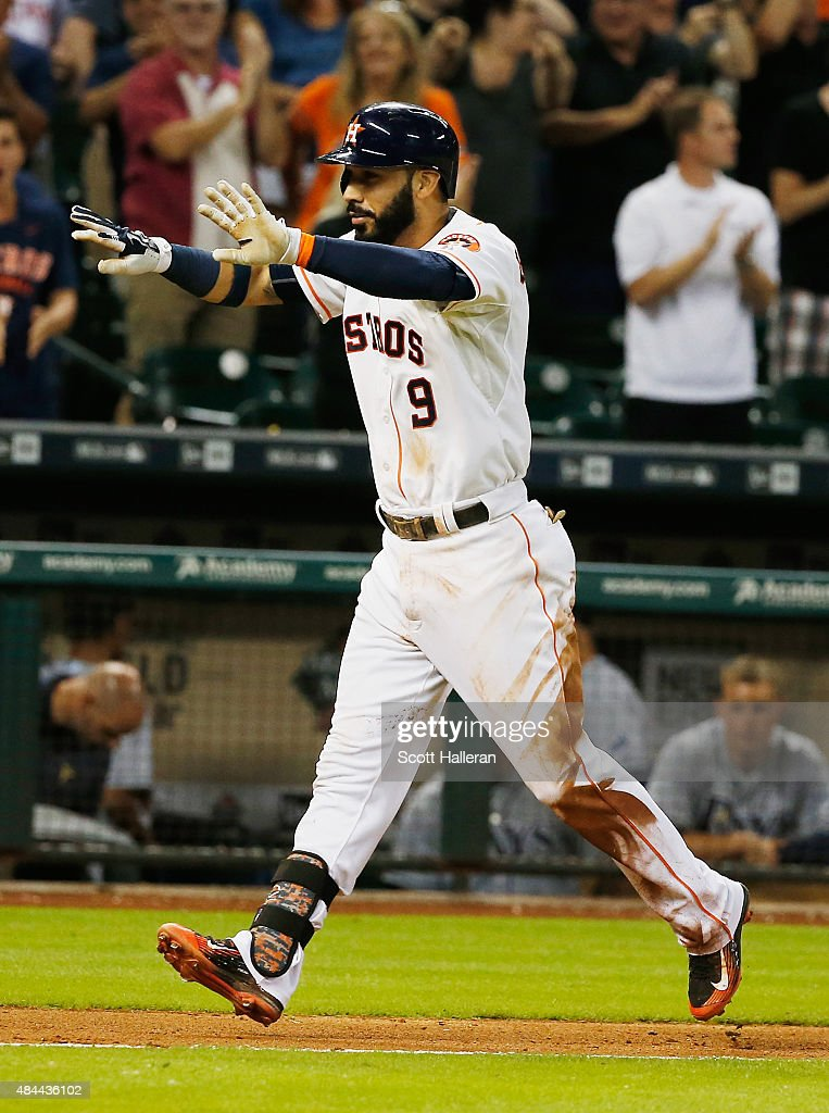 Marwin Gonzalez of the Houston Astros trots to home plate after his solo home run in the tenth inning to defeat the Tampa Bay Rays 32 at Minute Maid...