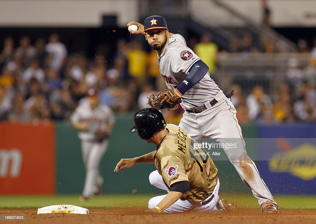 Marwin Gonzalez #9 of the Houston Astros turns a double play in the fifth inning against Jordy Mercer #10 of the Pittsburgh Pirates during the game on May 18, 2013 at PNC Park in Pittsburgh, Pennsylvania.