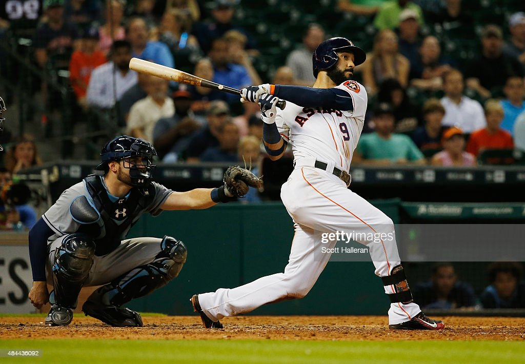 Marwin Gonzalez of the Houston Astros watches his solo home run in the tenth inning to defeat the Tampa Bay Rays 32 at Minute Maid Park on August 18...