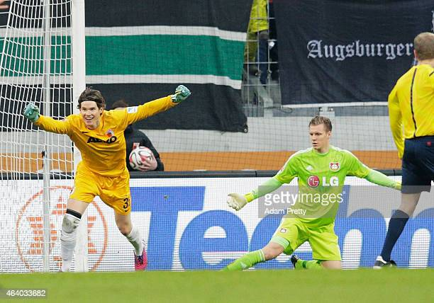 Marwin Hitz Goalkeeper of Augsburg celebrates after scoring a goal during the Bundesliga match between FC Augsburg and Bayer 04 Leverkusen at SGL...