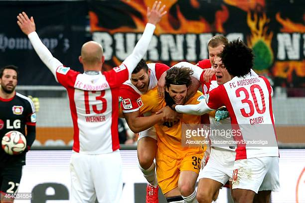 Marwin Hitz keeper of Augsburg celebrates scoring the 2nd team goal with his team mates during the Bundesliga match between FC Augsburg and Bayer 04...