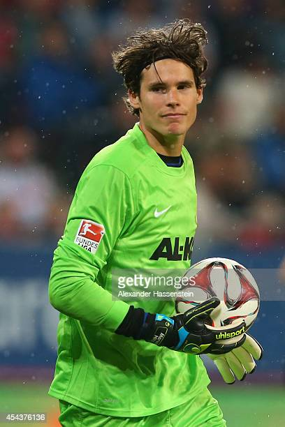 Marwin Hitz keeper of Augsburg safes the ball during the Bundesliga match between FC Augsburg and BVB Borussia Dortmund at SGL Arena on August 29...