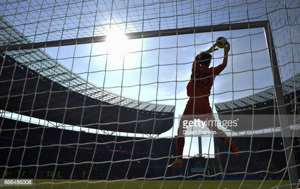 Marwin Hitz of Augsburg makes a save during the Bundesliga match between Hertha BSC and FC Augsburg at Olympiastadion on April 9 2017 in Berlin...