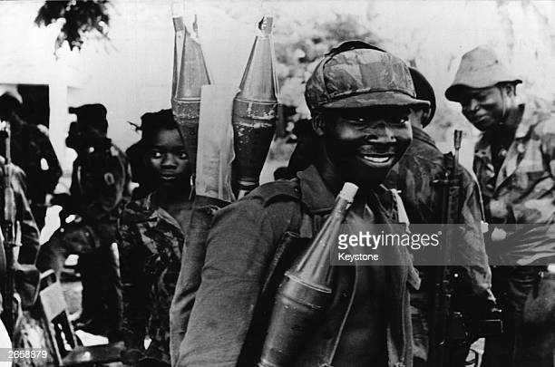 Marxist MPLA fighters equipped with shoulder rocket launchers and Soviet assault rifles near the town of Caxita during the civil war in Angola