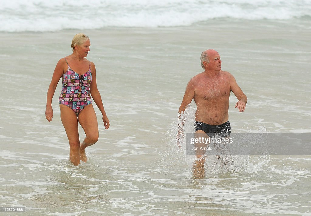 Mary and John Walter brave the wet and windy conditions at Bondi Beach on December 25, 2012 in Sydney, Australia. Traditionally beaches such as Bondi Beach are popular destinations for tourists and locals alike to celebrate Christmas Day.