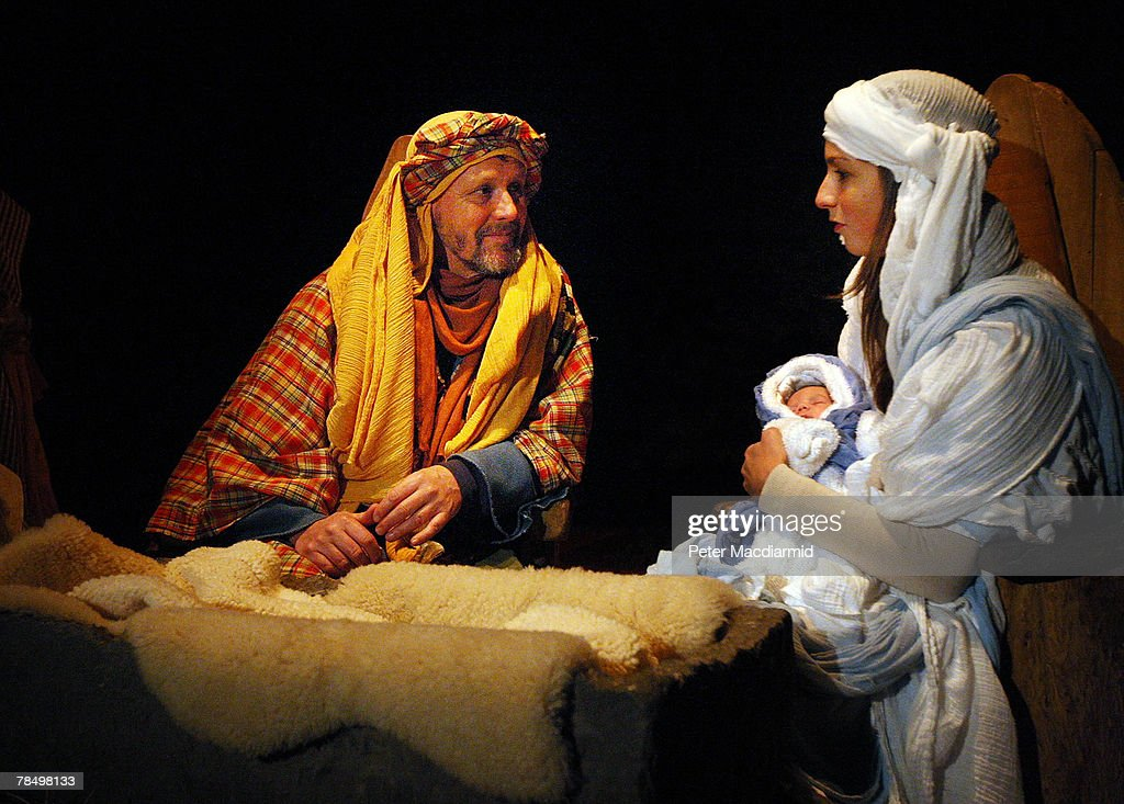 Mary and Joseph hold the baby Jesus in a performance of the nativity story at the Wintershall Estate Organic farm on December 14 2007 near Guildford...