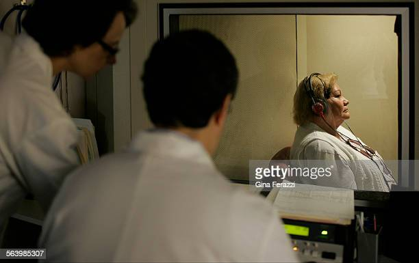 Mary Ann Gilbert director of audiology and co–ownerleft works with Dr Oscar Narro during a patients hearing test at Whittier Hearing Center Inc in...