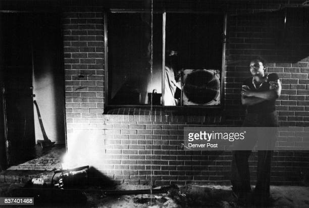 Mary Ann Huntington Is Lost In Thought Outside Her FireGutted Apartment At 1455 High St Fireman inside building finishes his work as fan clears smoke...