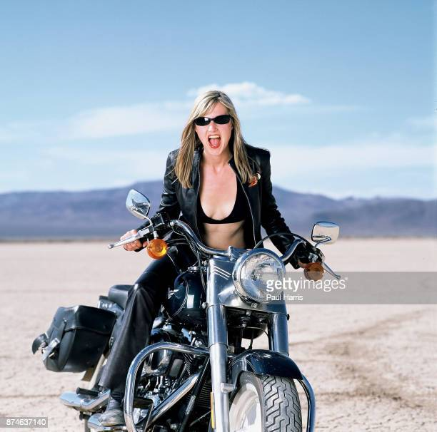 Mary Anne Hobbs a BBC Radio One presenter whilst filming a BBC Television documentary on Motorcycling throughout the World here on a Harley Davidson...