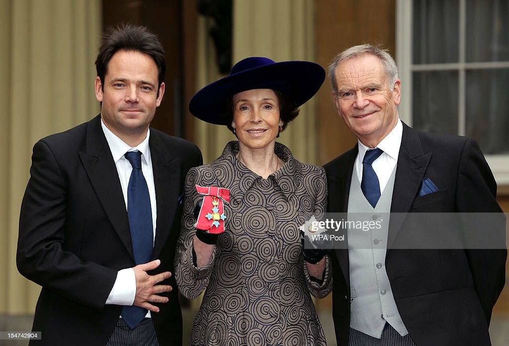 Mary Archer poses after she was made a Dame with her son William Archer (L) and husband <a gi-track='captionPersonalityLinkClicked' href=/galleries/search?phrase=Jeffrey+Archer&family=editorial&specificpeople=221280 ng-click='$event.stopPropagation()'>Jeffrey Archer</a> (R) at a Royal Investiture ceremony at Buckingham Palace on October 25, 2012 in London, England.
