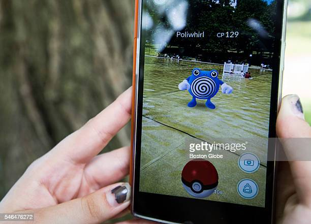 Mary Baker plays the mobile game Pokemon Go as she walks through the Public Garden in Boston Mass July 11 2016