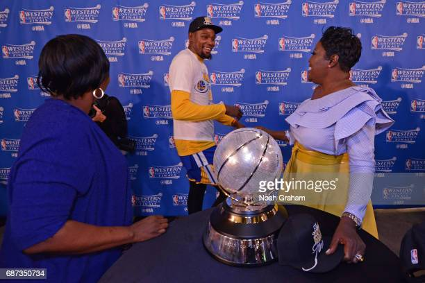Mary BarbersGreen and Wanda Durant congradulate Kevin Durant of the Golden State Warriors after winning Game Four of the Western Conference Finals...