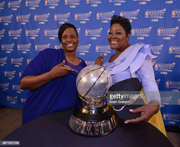Mary BarbersGreen and Wanda Durant pose for a photo with the Western Conference Championship Trophy after their sons win Game Four of the Western...