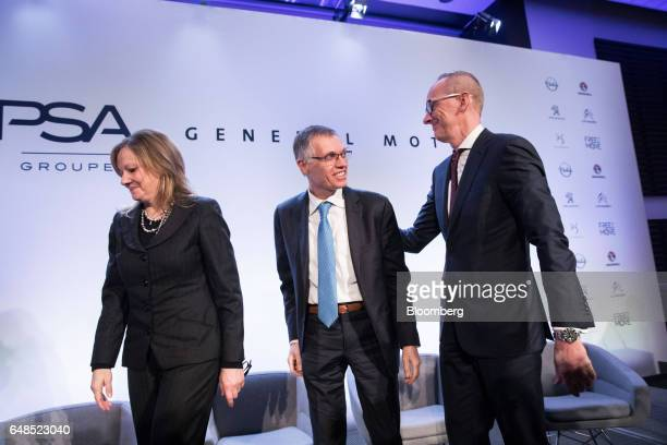 Mary Barra chairman and chief executive officer of General Motors Co left with Carlos Tavares chief executive officer of PSA Group center and...