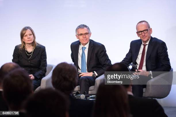Mary Barra chairman and chief executive officer of General Motors Co left sits with Carlos Tavares chief executive officer of PSA Group center and...