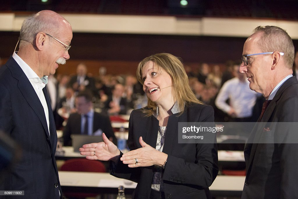 Mary Barra, chief executive officer of General Motors Co. (GM), center, speaks with Dieter Zetsche, chief executive officer of Daimler AG, left, as Karl-Thomas Neumann, chief executive officer of Adam Opel AG, looks on during the CAR Symposium in Bochum, Germany, on Thursday, Feb. 11, 2016. GM's German brand Opel will introduce its first fully electric car next year as part of a 29-model lineup overhaul, putting pressure on Volkswagen AG as it reels from the diesel-emissions scandal. Photographer: Martin Leissl/Bloomberg via Getty Images