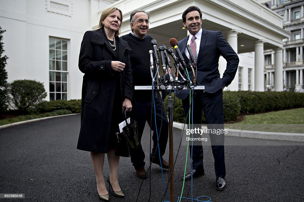 Mary Barra, chief executive officer of General Motors Co. (GM), left, speaks as Sergio Marchionne, chief executive officer of Fiat Chrysler Automobiles NV, center, and Mark Fields, president and chief executive officer of Ford Motor Co., smile during a news conference outside the White House after a meeting with U.S. President Donald Trump, not pictured, in Washington, D.C., U.S., on Tuesday, Jan. 24, 2017. Trump told chief executives of the three biggest U.S. automakers that environmental regulations are out of control and promised he would remove obstacles for manufacturers and oil companies. Photographer: Andrew Harrer/Bloomberg via Getty Images