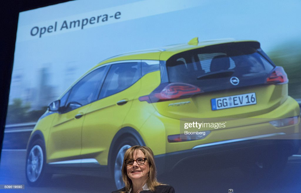 <a gi-track='captionPersonalityLinkClicked' href=/galleries/search?phrase=Mary+Barra&family=editorial&specificpeople=8289073 ng-click='$event.stopPropagation()'>Mary Barra</a>, chief executive officer of General Motors Co. (GM), speaks as an Opel Ampera-e electric automobile, manufactured by General Motors Co., is displayed on a screen during the CAR Symposium in Bochum, Germany, on Thursday, Feb. 11, 2016. GM's German brand Opel will introduce its first fully electric car next year as part of a 29-model lineup overhaul, putting pressure on Volkswagen AG as it reels from the diesel-emissions scandal. Photographer: Martin Leissl/Bloomberg via Getty Images