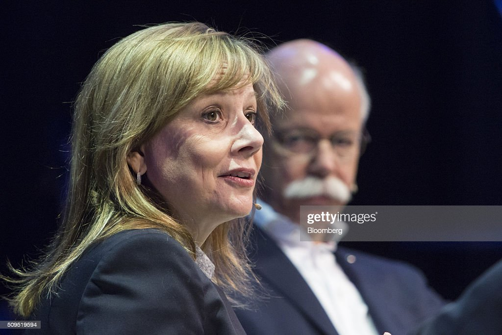 <a gi-track='captionPersonalityLinkClicked' href=/galleries/search?phrase=Mary+Barra&family=editorial&specificpeople=8289073 ng-click='$event.stopPropagation()'>Mary Barra</a>, chief executive officer of General Motors Co. (GM), speaks as Dieter Zetsche, chief executive officer of Daimler AG, looks on during a panel discussion at the CAR Symposium in Bochum, Germany, on Thursday, Feb. 11, 2016. General Motors Co.'s German brand Opel will introduce its first fully electric car next year as part of a 29-model lineup overhaul, putting pressure on Volkswagen AG as it reels from the diesel-emissions scandal. Photographer: Martin Leissl/Bloomberg via Getty Images