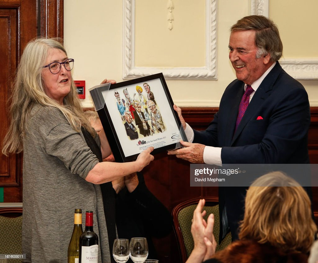 Mary Beard and <a gi-track='captionPersonalityLinkClicked' href=/galleries/search?phrase=Terry+Wogan&family=editorial&specificpeople=234787 ng-click='$event.stopPropagation()'>Terry Wogan</a> attend the Oldie of the Year Awards at Simpsons in the Strand on February 12, 2013 in London, England.