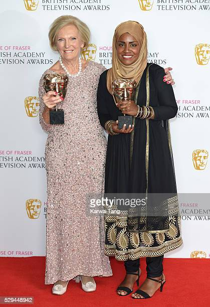 Mary Berry accepting the Feature award for 'The Great British Bake Off' and Bake Off winner Nadiya Hussain pose in the winners room at the House Of...