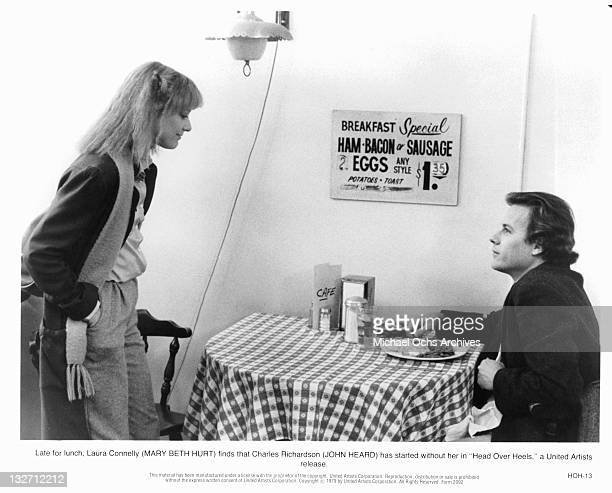 Mary Beth Hurt finds out that John Heard has begun his lunch without her in a scene from the film 'Head Over Heels' 1979