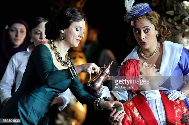 Mary Bevan as Elvira Ezgi Kutlu as Isabella and Quirijn de Lang as Mustafa with artists of the company in Garsington Opera's production of Gioachino...