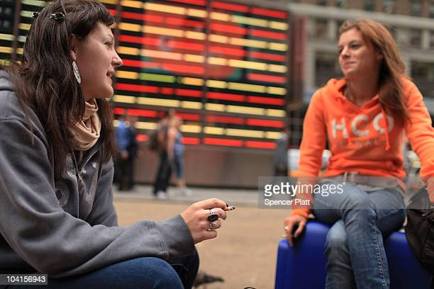 Mary Bynens and Avde Solbreux smoke in a Times Square pedestrian island on September 16 2010 in New York City New York City Mayor Michael Bloomberg...