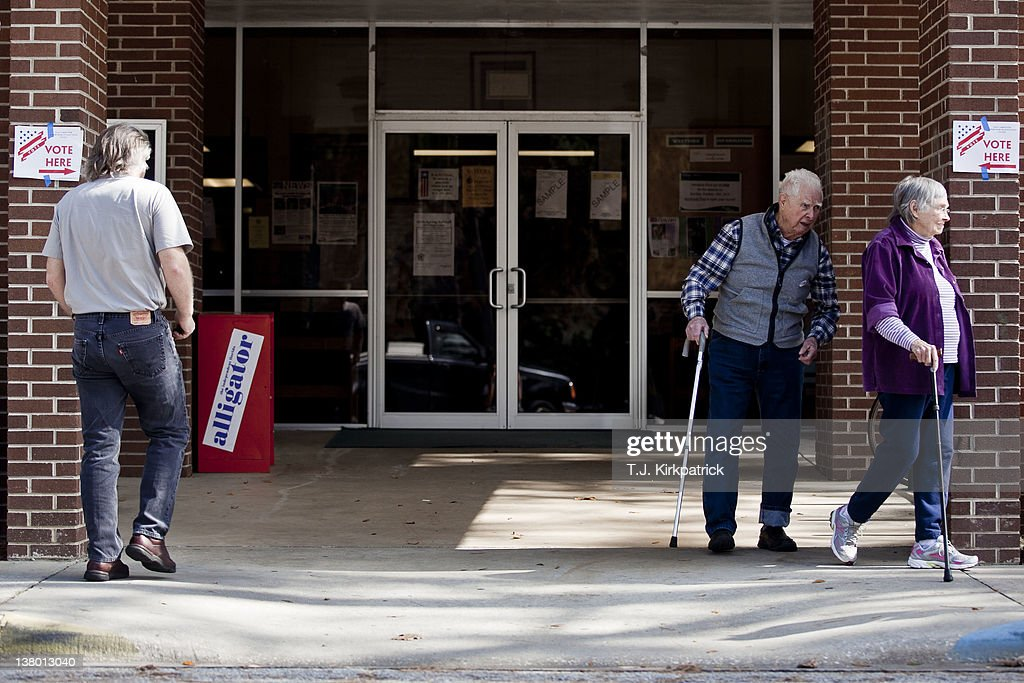 Mary Camp (R) and her husband Arthur Camp, of Gainesville, Florida, leave the polls after voting in the state's Republican Party primary at the Westside Recreation Center on January 31, 2012 in Gainesville, Florida. After a decisive South Carolina win, former House speaker Newt Gingrich has risen and fallen in the polls and trails former Massachusetts Gov. Mitt Romney by double digits going in to Florida's primary.