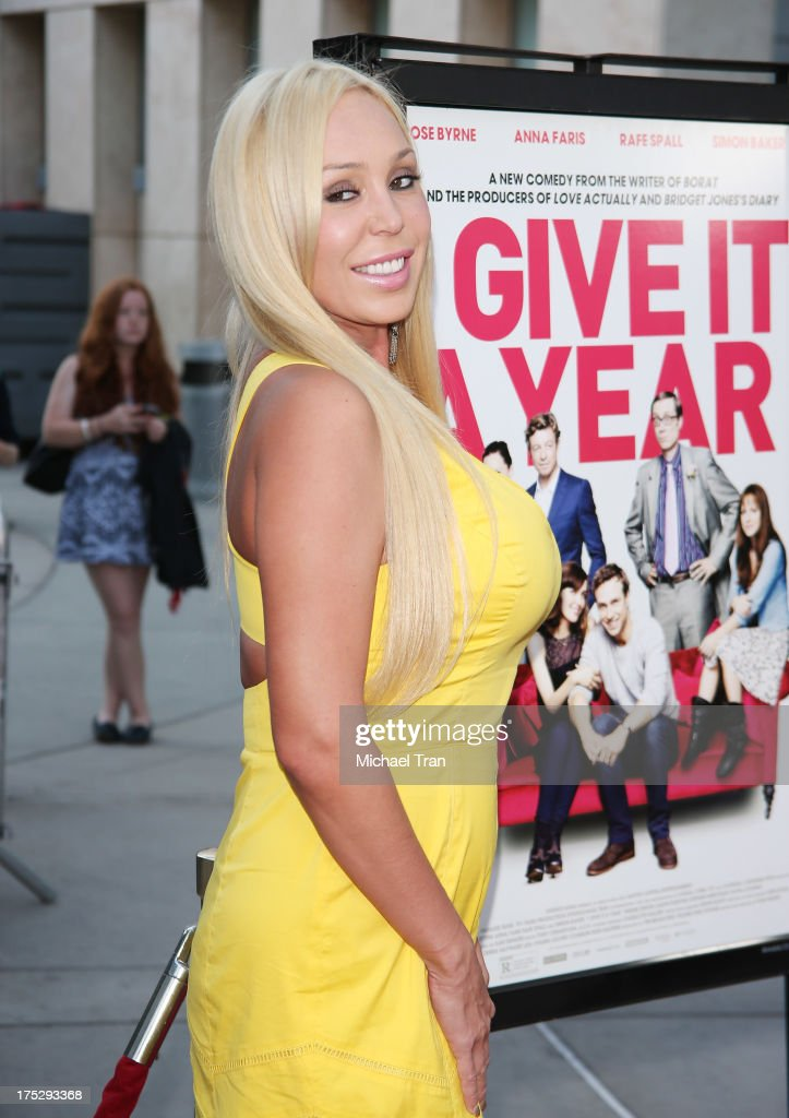<a gi-track='captionPersonalityLinkClicked' href=/galleries/search?phrase=Mary+Carey&family=editorial&specificpeople=211525 ng-click='$event.stopPropagation()'>Mary Carey</a> arrives at a Los Angeles special screening of 'I Give It A Year' held at ArcLight Hollywood on August 1, 2013 in Hollywood, California.