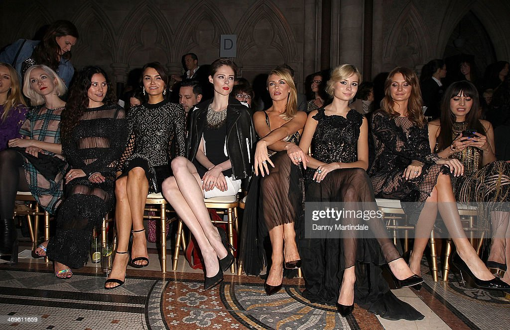 Mary Charteris, Portia Freeman, Eliza Doolittle, Samantha Barks, Coco Rocha, Abbey Clancy, Nina Nesbitt, Millie Mackintosh and Zara Martin attend the Julien Macdonald show at London Fashion Week AW14 at on February 15, 2014 in London, England.