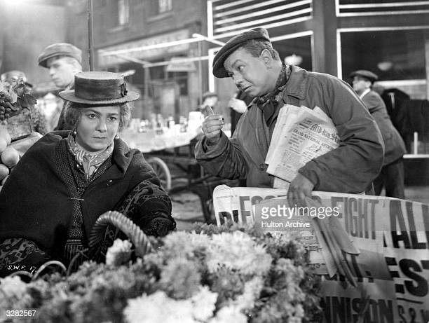 Mary Clare the British character actress in a scene from the film 'Say It With Flowers' about street traders who help a flower seller who becomes too...
