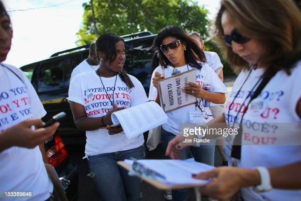 Mary Collante and Zunilda Boone along with other members of the Florida Immigrant Coalition prepare to go door to door looking to sign up voters...