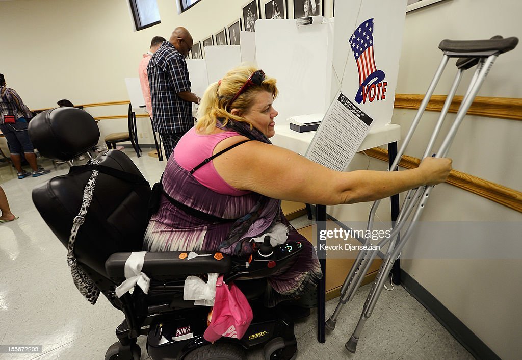 Mary Cowles, 40, (L) a resident of Downtown Women's Center, picks up her crutches after casting her ballot as residents of Skid Row vote in the US presidential elections in the polling place of Los Angeles Mission on November 6, 2012 in Los Angeles, California. Californians will cast ballots in dozens of tight races including Gov. Jerry Brown's tax plan, abolishing the death penalty, easing the state's strict 'three strikes' sentencing law and also in the Presidential race between Democratic President Barack Obama and Republican candidate Mitt Romney.