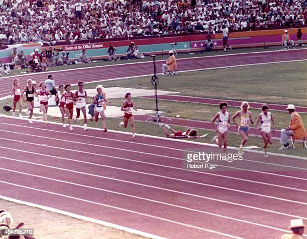 Mary Decker of the United States falls to the ground after sustaining a hip injury after bumping England Zola Budd during the 300M woman's race...