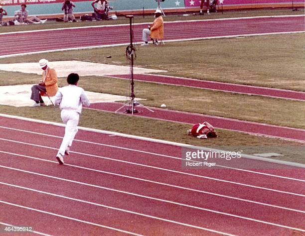 Mary Decker of the United States lies on the ground after sustaining a hip injury after bumping England's Zola Budd during the 300M woman's race...