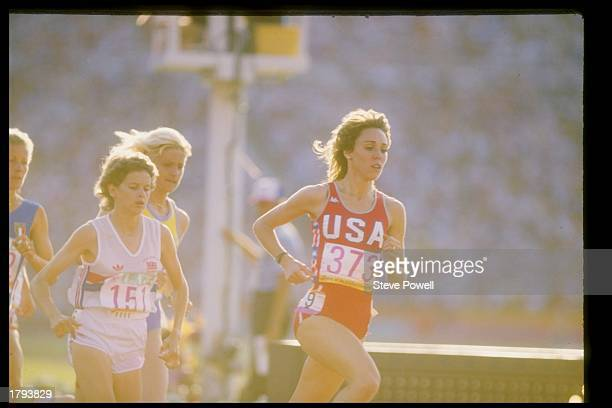 Mary Decker of the United States runs against Zola Budd during the Summer Olympics in Los Angeles California