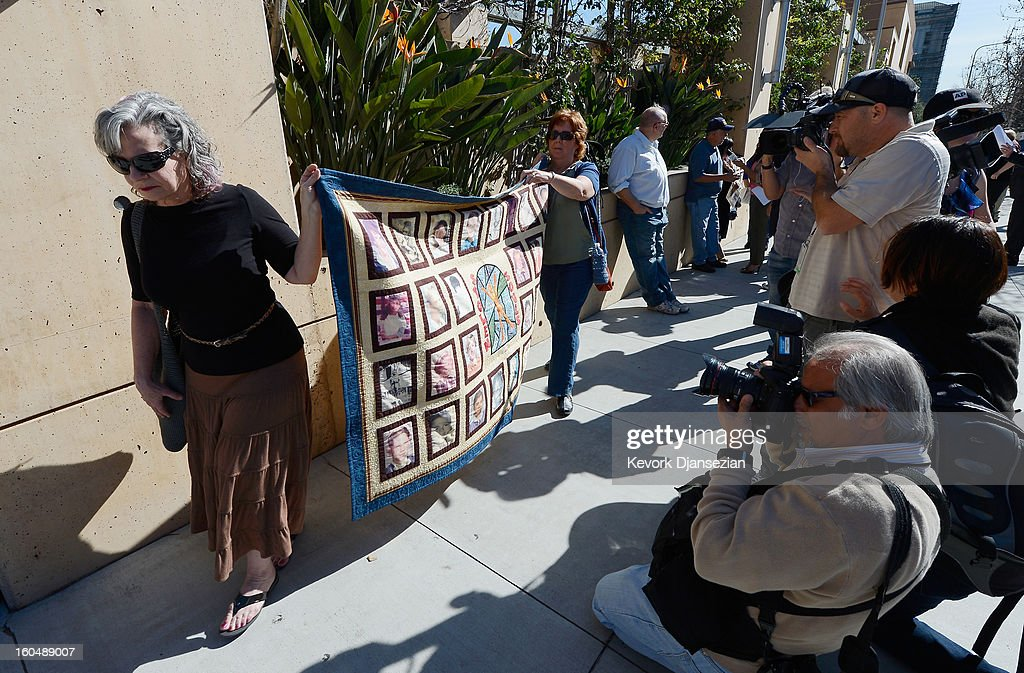 Mary Desantis (L) and Margaret Schettler hold up a quilt with pictures of alleged victims of sexual abuse by priests in the Catholic Archdiocese of Los Angeles during a news conference urging victims to come forward on February 1, 2013 at Cathedral of Our Lady of the Angels in Los Angeles, California. Retired Cardinal Roger Mahony of Catholic Archdiocese of Los Angeles, who avoided criminal charges over the way he handled pedophile priests during his career, was reportedly stripped of his archdiocese duties February 1, by his successor Archbishop Jose Gomez.