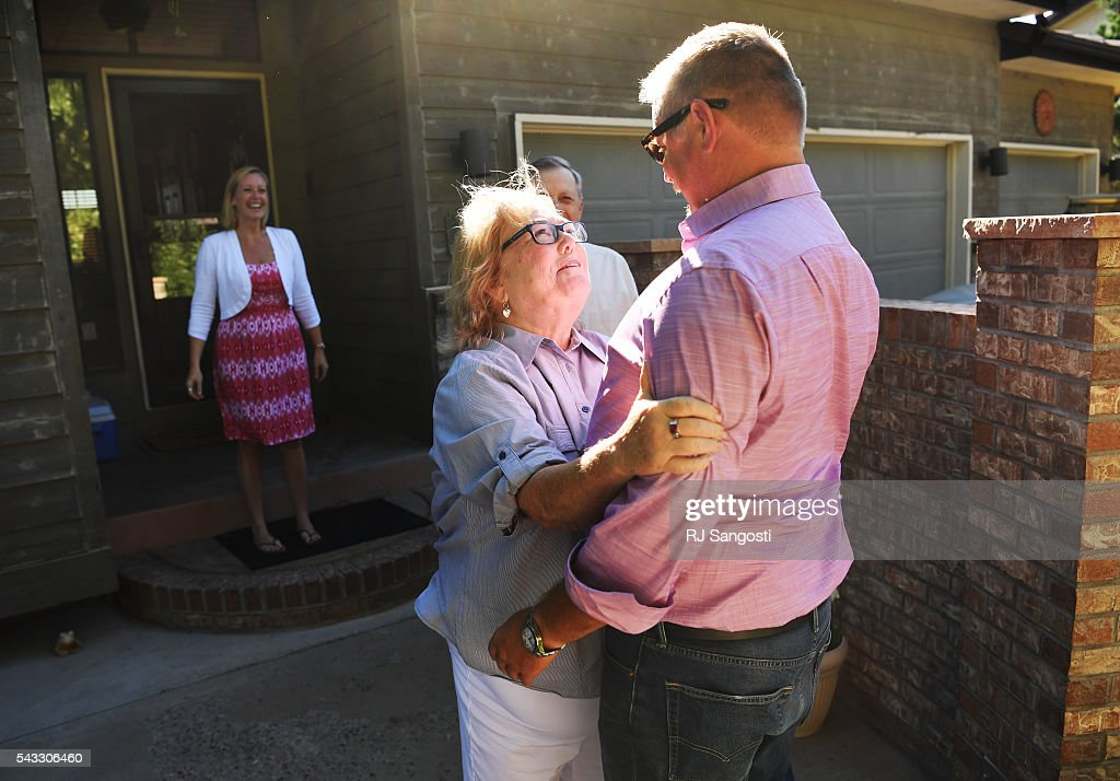 Mary Drotar looks up at her son Patrick Meeker after he arrived from the airport outside her home in Littleton, June 24, 2016. Mary and her husband Barry put Meeker up for adoption when they were teenage parents. Meeker is coming from St. Louis to meet this birth parents and other family. Meeker used Ancestry.com's DNA test to track down a couple of second cousins and, eventually, connect with his birth parents.