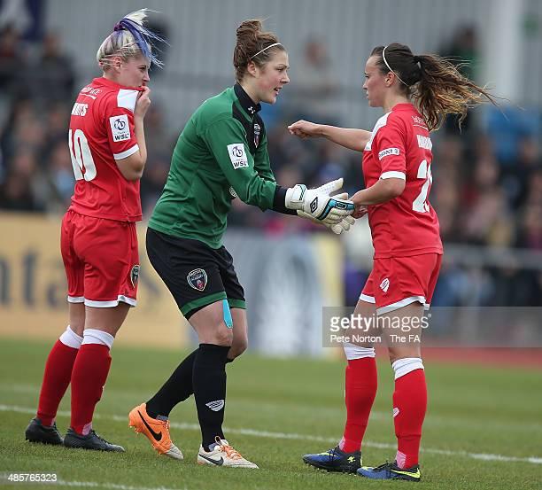Mary Earps of Bristol Academy Women talks to team mate Natasha Harding as Nikki Watts looks on during the FA WSL 1 match between Manchester City...