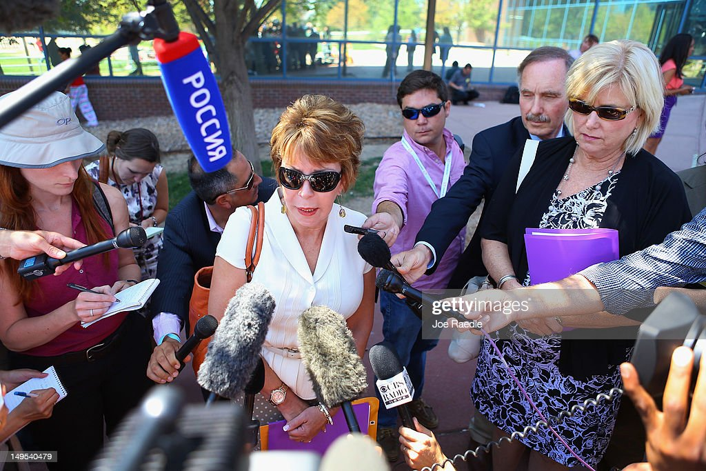 Mary Ellen Hansen the aunt of Ashley Moser who was killed during the shooting at the screening of, ' The Dark Knight Rises, speaks to the media outside the Arapahoe County Courthouse after attending an arraignment hearing for suspect James Holmes on July 30, 2012 in Centennial, Colorado. James Holmes, 24, who is accused of killing 12 people and injuring 58 in a shooting spree July 20, during a screening of 'The Dark Knight Rises.' in Aurora, Colorado was charged with 24 counts of first-degree murder and 116 counts of attempted murder.
